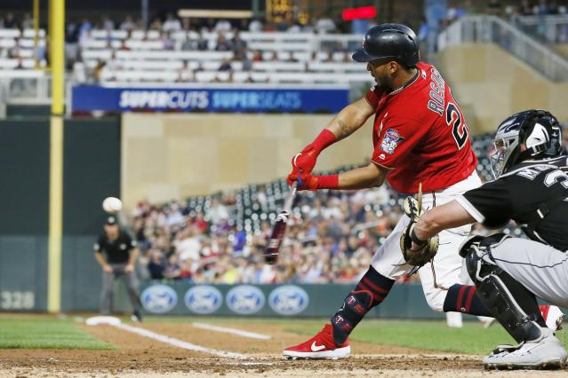 Minnesota Twins' Eddie Rosario hits an RBI double off Chicago White Sox pitcher Ross Detwiler in the third inning of a baseball game Tuesday, Sept. 17, 2019, in Minneapolis. (AP Photo/Jim Mone)