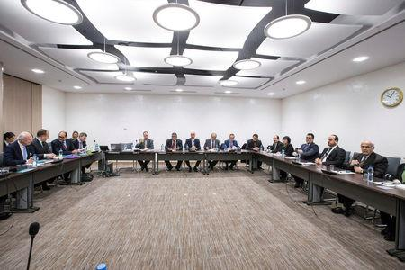 United Nations Special Envoy of the Secretary-General for Syria Staffan de Mistura, and Naser al-Hariri, Head of the Syrian Negotiation Commission (SNC), attend a round of negotiations during the Intra Syria talks, at the European headquarters of the U.N. in Geneva, Switzerland December 14, 2017. REUTERS/Xu Jinquan/Pool