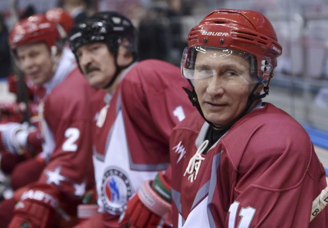Russian President Vladimir Putin (R) and his Belarussian counterpart Alexander Lukashenko (C) take part in a friendly ice hockey match in the Bolshoi Ice Palace near Sochi January 4, 2014. REUTERS/Alexei Nikolskiy/RIA Novosti/Kremlin (RUSSIA - Tags: POLITICS SPORT OLYMPICS ICE HOCKEY) ATTENTION EDITORS - THIS IMAGE HAS BEEN SUPPLIED BY A THIRD PARTY. IT IS DISTRIBUTED, EXACTLY AS RECEIVED BY REUTERS, AS A SERVICE TO CLIENTS