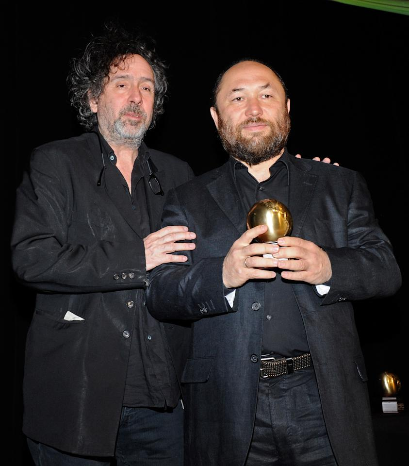 LAS VEGAS, NV - APRIL 23:  Director Tim Burton (L) presents director Timur Bekmambetov with the International Filmmaker of the Year Award at Caesars Palace during CinemaCon, the official convention of the National Association of Theatre Owners, April 23, 2012 in Las Vegas, Nevada.  (Photo by Ethan Miller/Getty Images)