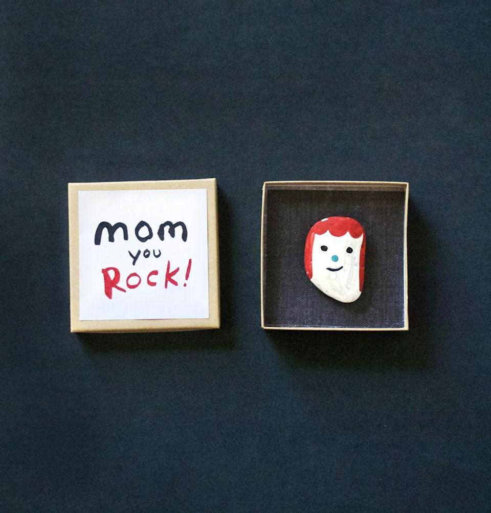 """<p>Who knew something so simple could be so sweet? All a backyard rock needs is a little bit of paint and a lot of creativity. </p><p><strong>Get the tutorial at <a href=""""http://mermagblog.com/make-a-rock-portrait-for-mom/"""" rel=""""nofollow noopener"""" target=""""_blank"""" data-ylk=""""slk:Mer Mag"""" class=""""link rapid-noclick-resp"""">Mer Mag</a>. </strong></p><p><strong><a class=""""link rapid-noclick-resp"""" href=""""https://www.amazon.com/Apple-Barrel-Acrylic-PROMOABI-Assorted/dp/B00ATJSD8I/?tag=syn-yahoo-20&ascsubtag=%5Bartid%7C10050.g.4233%5Bsrc%7Cyahoo-us"""" rel=""""nofollow noopener"""" target=""""_blank"""" data-ylk=""""slk:SHOP PAINT"""">SHOP PAINT</a><br></strong></p>"""