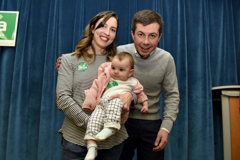 South Bend Mayor Pete Buttigieg poses for a photo with Tina Belge and her daughter 7-month-old Sammy Pocta after speaking to a crowd during the Democratic monthly breakfast at the Circle of Friends Community Center in Greenville, S.C. Buttigieg was the longest of long shots when he announced a presidential exploratory committee in January. But now the underdog bid is gaining momentum, and Buttigieg can feel it. (AP Photo/Richard Shiro)