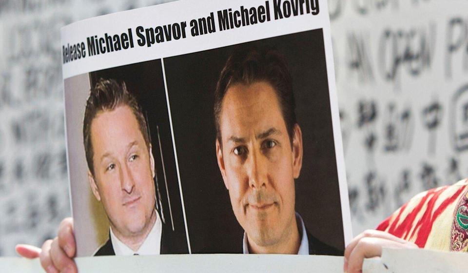 Turnisa Matsedik-Qira of the Vancouver Uygur Association demonstrates against China's treatment of Uygurs while holding a photo of detained Canadians Michael Spavor (left) and Michael Kovrig outside a Vancouver court appearance for Huawei Chief Financial Officer Meng Wanzhou in May 2019. Photo: AFP