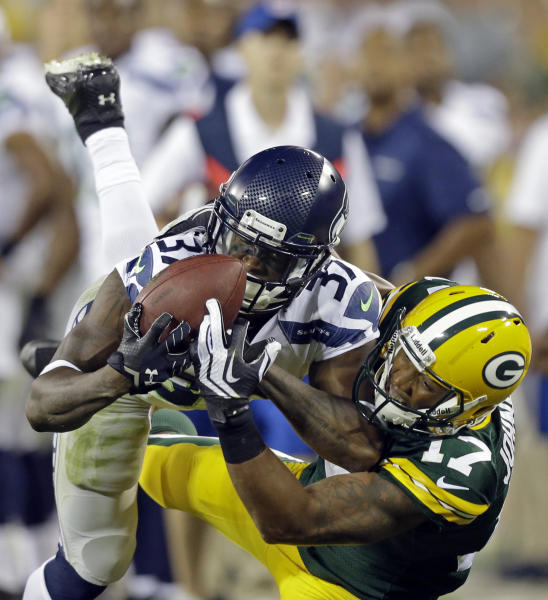 Seattle Seahawks' Will Blackmon catches a ball in front of Green Bay Packers' Charles Johnson (17) during the second half of an NFL preseason football game Friday, Aug. 23, 2013, in Green Bay, Wis. Blackmon was called for pass interference on the play. (AP Photo/Jeffrey Phelps)