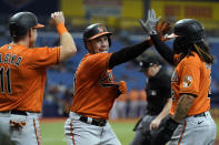Baltimore Orioles' Austin Wynns, center, celebrates his grand slam off Tampa Bay Rays starting pitcher Rich Hill with Pat Valaika, left, and Freddy Galvis, right, during the fifth inning of a baseball game Saturday, June 12, 2021, in St. Petersburg, Fla. (AP Photo/Chris O'Meara)
