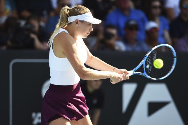 United States' Amanda Anisimova makes a return during her semifinal match against United States' Serena Williams at the ASB Classic in Auckland, New Zealand, Saturday, Jan. 11, 2020. (Chris Symes/Photosport via AP)