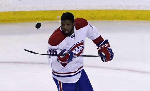 Montreal Canadiens defenseman P.K. Subban flips the puck prior to facing the Boston Bruins in Game 2 in the second-round of the Stanley Cup hockey playoff series in Boston, Saturday, May 3, 2014. (AP Photo/Charles Krupa)