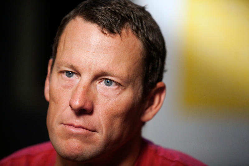 FILE - In this Feb. 15, 2011 file photo, Lance Armstrong pauses during an interview in Austin, Texas.Armstrong, on Thursday, April 19, 2018, has reached a $5 million settlement with the federal government in a whistleblower lawsuit that could have sought $100 million in damages from the cyclist who was stripped of his record seven Tour de France victories after admitting he used performance-enhancing drugs throughout much of his career. (AP Photo/Thao Nguyen, File)