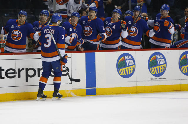 New York Islanders defenseman Adam Pelech (3) celebrates with teammates after scoring a goal against the Vegas Golden Knights during the second period of an NHL hockey game, Wednesday, Dec. 12, 2018, in New York. (AP Photo/Noah K. Murray)