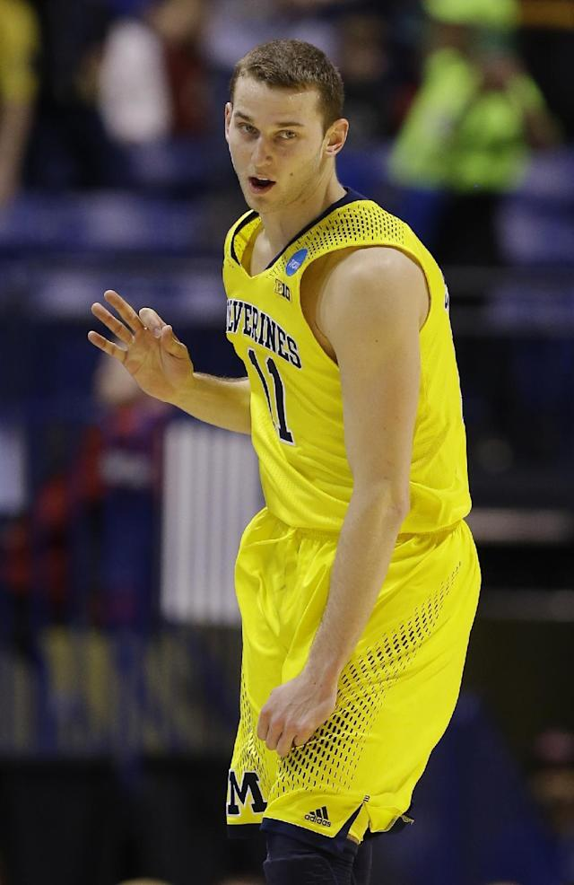 Michigan's Nik Stauskas reacts after making a three-point basket during the first half of an NCAA Midwest Regional semifinal college basketball tournament game against the Tennessee Friday, March 28, 2014, in Indianapolis. (AP Photo/Michael Conroy)