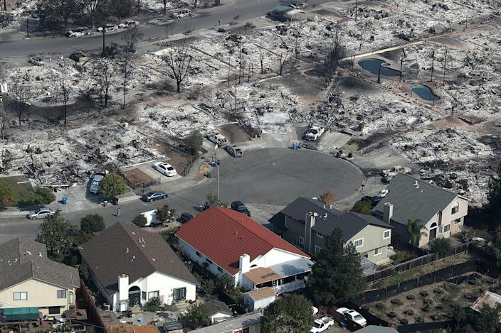 """<span class=""""caption"""">Fire in one part of a community can contaminate the water system used by other residents, as Santa Rosa, California, discovered after the Tubbs Fire.</span> <span class=""""attribution""""><a class=""""link rapid-noclick-resp"""" href=""""https://www.gettyimages.com/detail/news-photo/an-aerial-view-of-homes-that-were-destroyed-by-the-tubbs-news-photo/860298200"""" rel=""""nofollow noopener"""" target=""""_blank"""" data-ylk=""""slk:Justin Sullivan/Getty Images"""">Justin Sullivan/Getty Images</a></span>"""