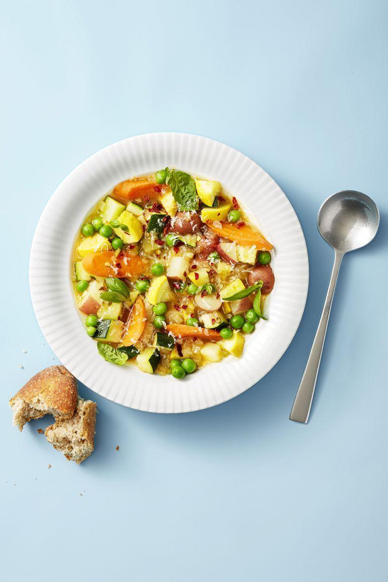 """<p>Get a sweet taste of summertime with this colorful soup loaded with peas, zucchini, squash, and carrots. </p><p><em><a href=""""https://www.goodhousekeeping.com/food-recipes/easy/a22566145/summer-minestrone-recipe/"""" rel=""""nofollow noopener"""" target=""""_blank"""" data-ylk=""""slk:Get the recipe for Summer Minestrone »"""" class=""""link rapid-noclick-resp"""">Get the recipe for Summer Minestrone »</a></em></p>"""