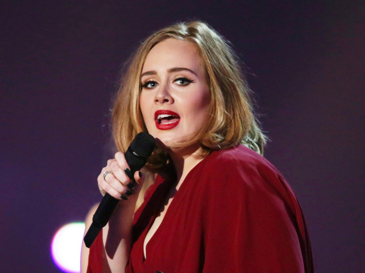 """FILE - In this Feb. 24, 2016 file photo shows Adele onstage at the Brit Awards 2016 at the 02 Arena in London. Adele and Beyonce are the top nominees at the MTV Video Music Awards, where their music videos will compete against Kanye West's controversial """"Famous"""" for video of the year. The VMAs will air live Aug. 28 from New York's Madison Square Garden. (Photo by Joel Ryan/Invision/AP, File)"""