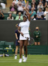 Venus Williams of the US celebrates winning the women's singles first round match against Romania's Mihaela Buzarnescu on day two of the Wimbledon Tennis Championships in London, Tuesday June 29, 2021. (AP Photo/Alastair Grant)