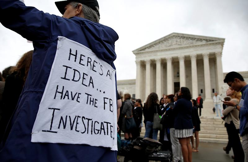 Demonstrators protest against Supreme Court nominee Brett Kavanaugh in front of the Supreme Court building in Washington on Monday. (Joshua Roberts / Reuters)