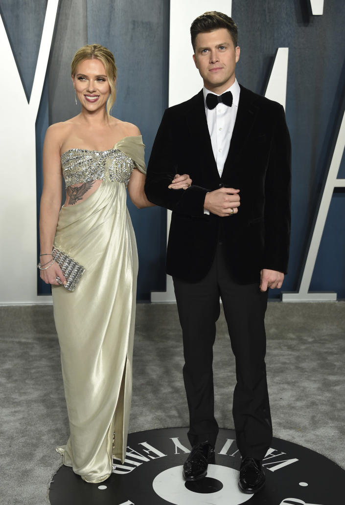 """FILE - Scarlett Johansson, left, and Colin Jost arrive at the Vanity Fair Oscar Party on Feb. 9, 2020, in Beverly Hills, Calif. Johansson is a mom to two now. The """"Black Widow"""" star recently gave birth to a son, Cosmo, with husband Colin Jost, the """"Saturday Night Live"""" star said on Instagram Wednesday, Aug. 18, 2021. This is the first child for the couple, who were married last October. (Photo by Evan Agostini/Invision/AP, File)"""