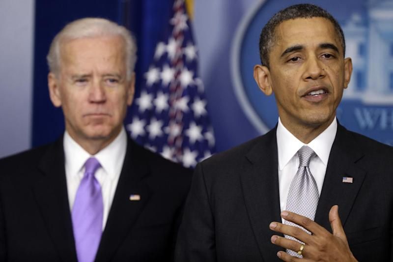 FILE - President Barack Obama stands with Vice President Joe Biden as he makes a statement in this Dec. 19, 2012 file photo taken in the Brady Press Briefing Room at the White House in Washington, about policies he will pursue following the massacre at Sandy Hook Elementary School in Newtown, Ct. Facing an end-of-the-month deadline, the Obama administration is calling gun owner groups, victims' organizations and representatives from the video-game industry to the White House Biden will meet Wednesday  Jan. 9, 2013 with gun violence victims' groups and gun safety organizations, a White House official said. On Thursday, he will hold talks with gun ownership groups, as well as advocates for sportsmen. for discussions on potential policy proposals for curbing gun violence.  (AP Photo/Charles Dharapak)