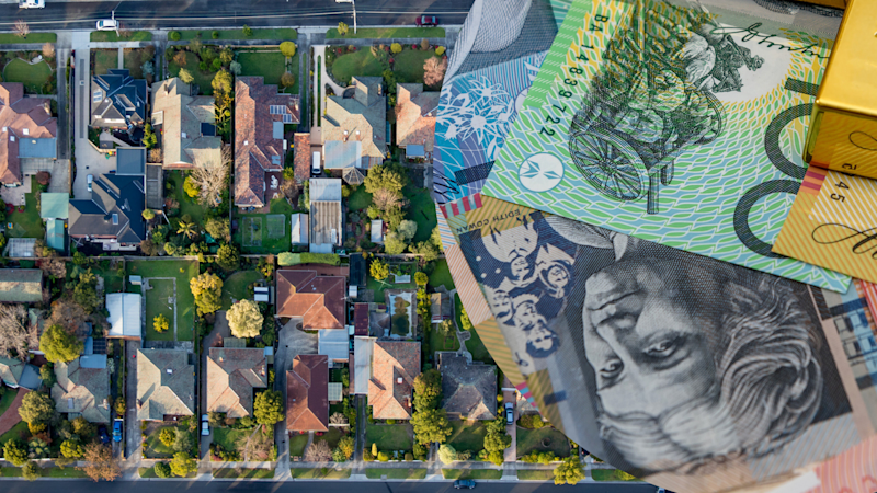 Pictured: Aerial view of Australian suburbs, Australian cash. Images: Getty