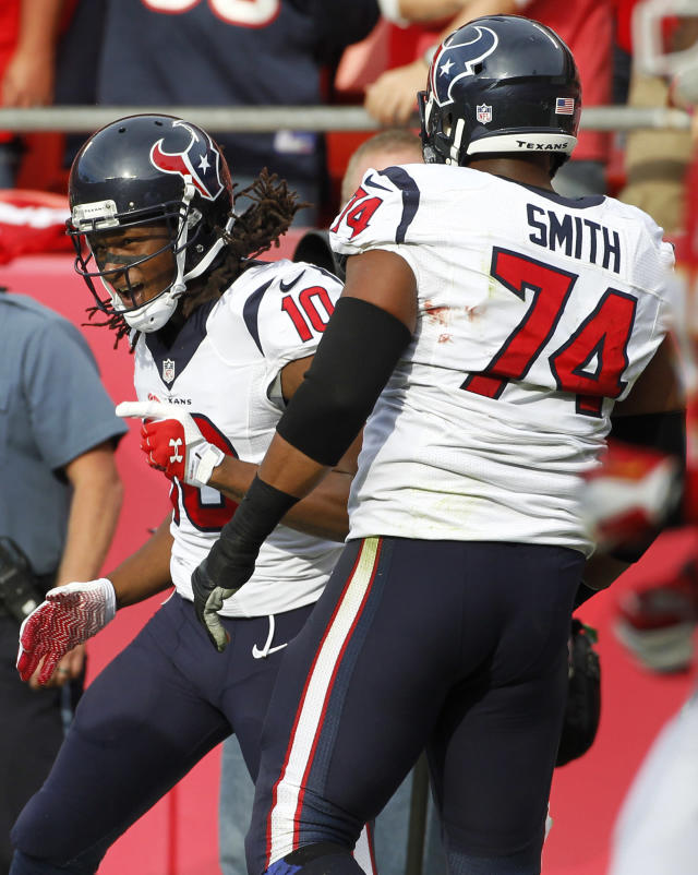 Houston Texans wide receiver DeAndre Hopkins (10) celebrates his touchdown with guard Wade Smith (74) during the first half of an NFL football game against the Kansas City Chiefs at Arrowhead Stadium in Kansas City, Mo., Sunday, Oct. 20, 2013. (AP Photo/Colin E. Braley)