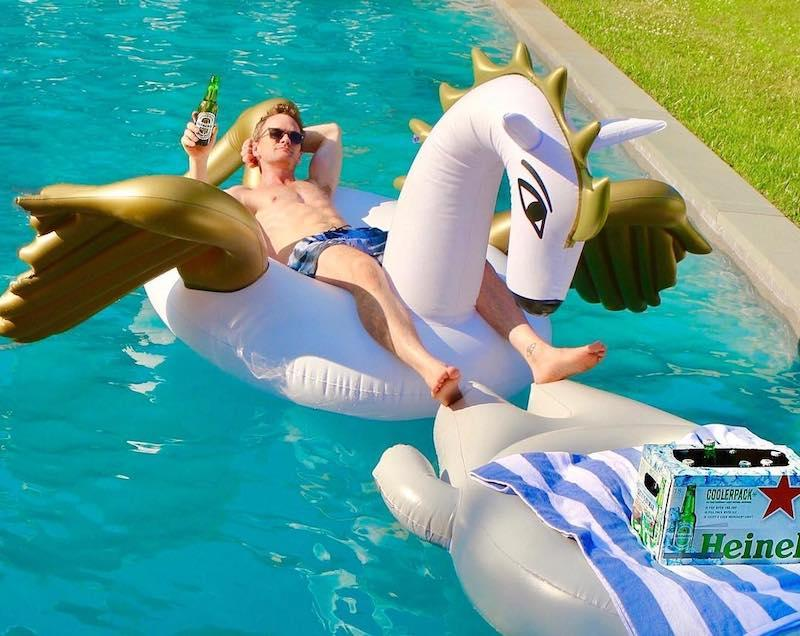 "<p>Pegasus, meet Neil Patrick Harris. The actor enjoyed his pool float with some cool ones. ""Behold: the pegasus of light beers has arrived. #HeinekenLightPartner#Coolerpack,"" Harris tweeted.<br /> (Photo: Neil Patrick Harris <a rel=""nofollow"" href=""https://www.instagram.com/p/BWI0snMhsZO/?taken-by=nph"">via Instagram</a>)<br /><br /></p>"