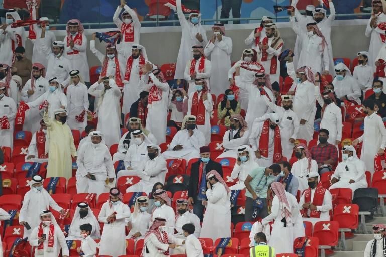 Mostly socially distanced fans watch a domestic cup final at the inauguration of Qatar's new Ahmad Bin Ali stadium, which will host World Cup 2022 matches