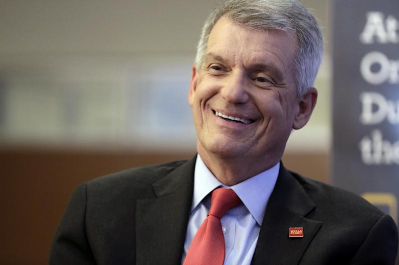 FILE - In this Friday, March 17, 2017, file photo, Wells Fargo CEO & President Timothy Sloan is interviewed in one of his bank's branches in New York. On Tuesday, March 21, 2017, Wells Fargo announced plans to upgrade all 13,000 of its ATMs to allow customers to access their funds using their cellphones instead of traditional bank cards. (AP Photo/Richard Drew, File)