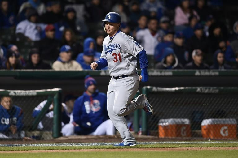 Joc Pederson of the Los Angeles Dodgers scores during the sixth inning of their game against the Chicago Cubs, at Wrigley Field in Chicago, Illinois, on April 10, 2017