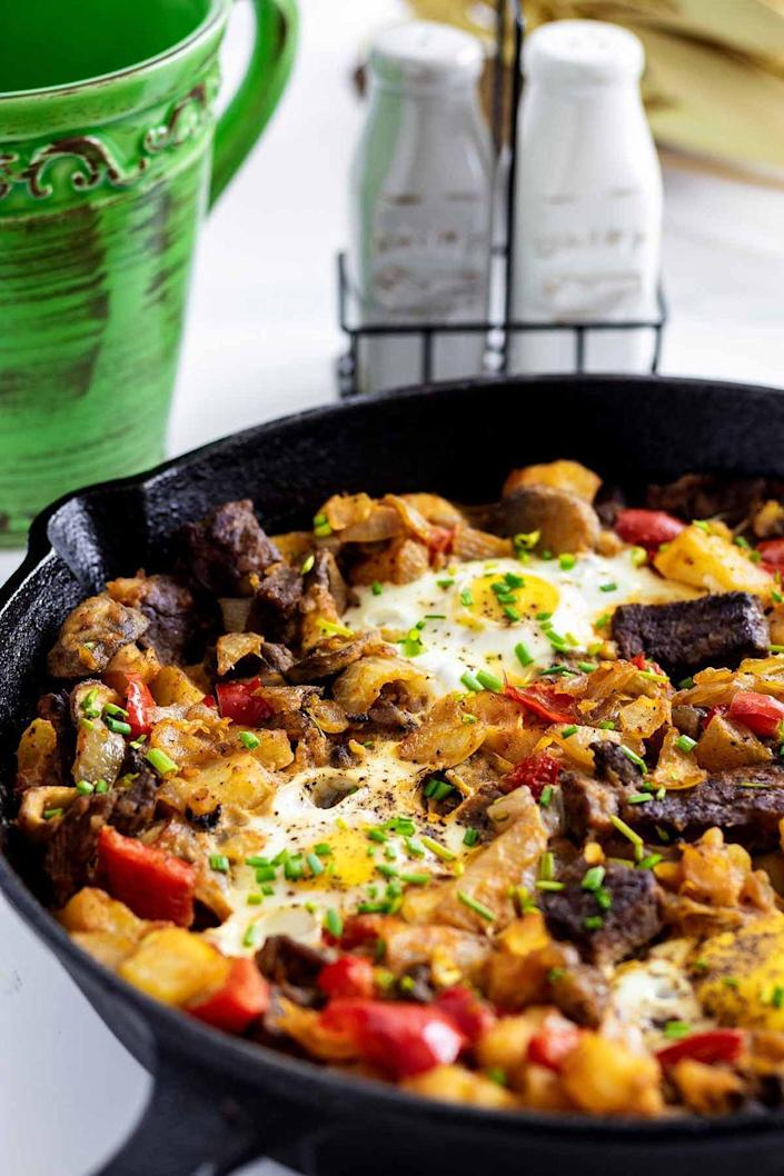 """<p>Turn leftover steak <em>and</em> leftover potatoes into a morning feast with this easy breakfast hash. </p><p><strong>Get the recipe at <a href=""""https://heavenlyhomecooking.com/steak-and-eggs-hash/"""" rel=""""nofollow noopener"""" target=""""_blank"""" data-ylk=""""slk:Heavenly Home Cooking"""" class=""""link rapid-noclick-resp"""">Heavenly Home Cooking</a>.</strong></p>"""