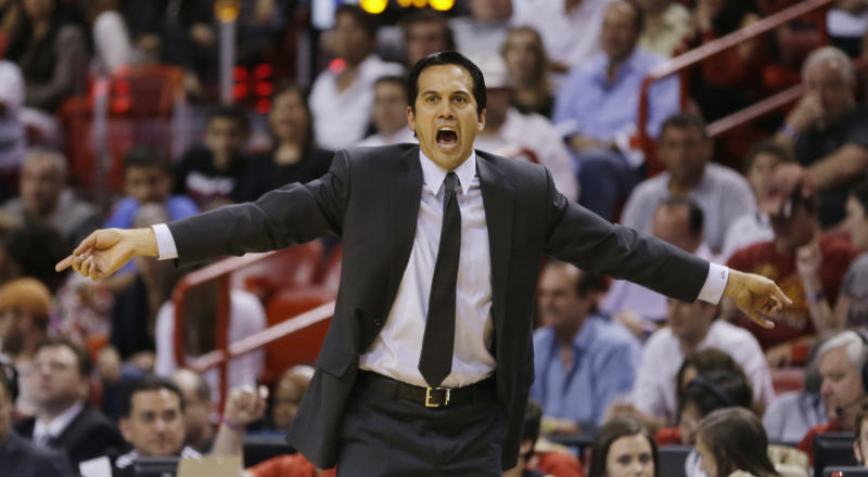 Miami Heat's coach Erik Spoelstra reacts to a foul call during the first half of a NBA basketball game in Miami, Friday, March 8, 2013 against the Philadelphia 76ers. (AP Photo/J Pat Carter)