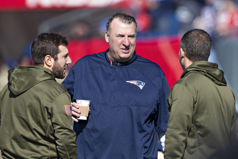 New England Patriots assistant coach Bret Bielema talks on the field before a game against the Tennessee Titans on Nov. 11, 2018. (Getty)