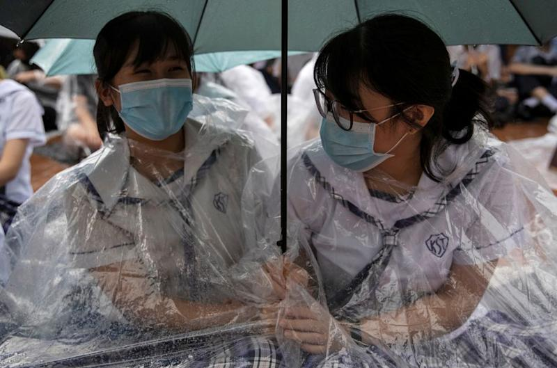 Two schoolgirls participate in a boycott of their classes in protest against the government in Hong Kong on September 2, 2019