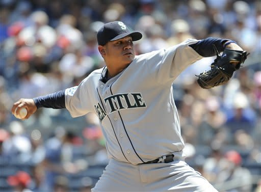 Seattle Mariners starting pitcher Felix Hernandez throws to a New York Yankees batter in the first inning of a baseball game Saturday, Aug., 4, 2012, at Yankee Stadium in New York. (AP Photo/Kathy Kmonicek)