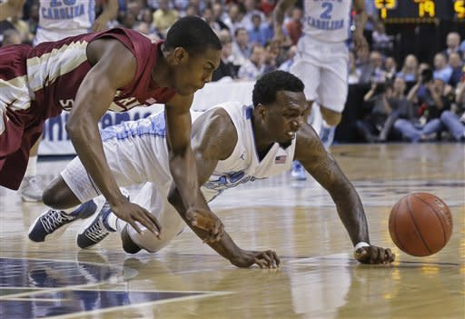 Florida State's Montay Brandon, left, and North Carolina's P.J. Hairston, right, chase a loose ball during the first half of an NCAA college basketball game at the Atlantic Coast Conference men's tournament in Greensboro, N.C., Friday, March 15, 2013. (AP Photo/Gerry Broome)