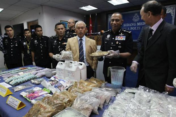 Datuk Seri Mohamad Salleh (in beige jacket) is pictured with the seized synthetic drugs during a media conference in Johor Baru November 2, 2017. ― Picture by Roslan Khamis