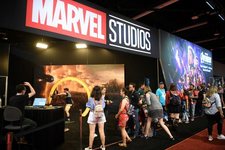 """Attendees visit the Marvel Studios booth at the D23 Expo, billed as the """"largest Disney fan event in the world,"""" August 23, 2019 at the Anaheim Convention Center in California (AFP Photo/Robyn Beck)"""