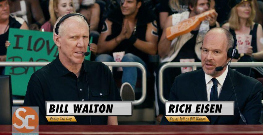 Both Bill and Rich are sports reporters, so they're appropriate choices to play commentators in Katy's 'Tigers vs. Sheep' basketball game.