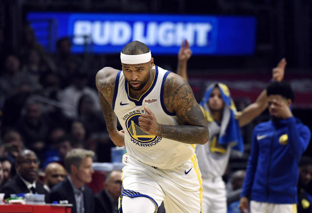 DeMarcus Cousins sprints up the court against the Clippers on Friday night. (Getty)