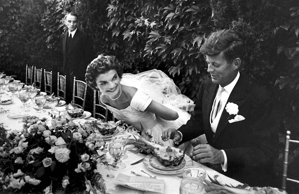 <p>The happy couple sat down to eat their pineapple salads as the reception rolled on.</p>