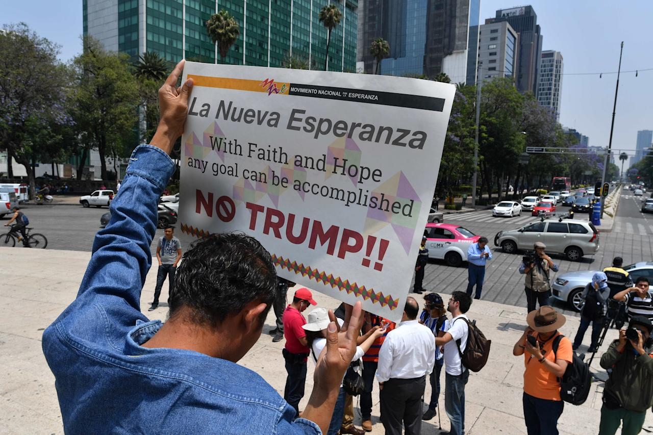 "<p>Central American migrants takes part in the ""Migrant Via Crucis"" caravan towards the United States, and participate in a protest against the policies of US President Donald Trump in front of the US embassy bulding in Mexico City on April 7, 2018. (Photo: Yuri Cortez/AFP/Getty Images) </p>"
