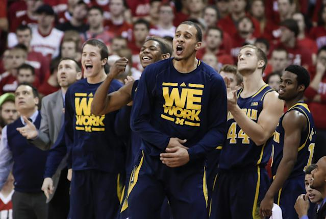 Michigan players cheer on their team during the second half of Michigan's 77-70 win over Wisconsin in an NCAA college basketball game Saturday, Jan. 18, 2014, in Madison, Wis. (AP Photo/Andy Manis)