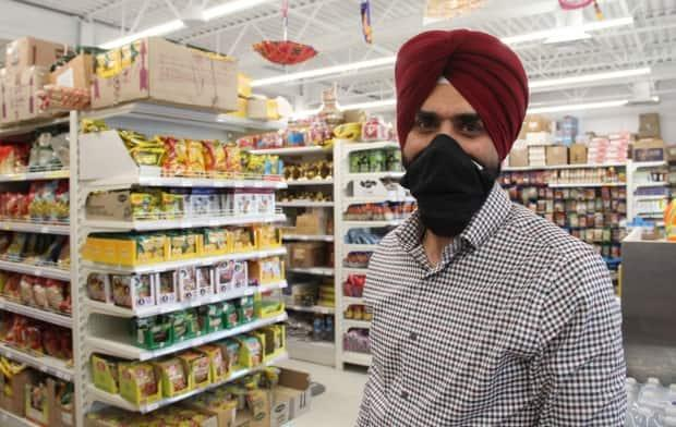 Jagjit Gill, owner of Gill's Supermarket, said his Keewatin Street store saw decreased business for three months after a false rumour that several of his employees had COVID-19.