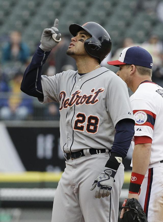 Detroit Tigers' J.D. Martinez (28) celebrates after hitting a double against the Chicago White Sox during the fourth inning of a baseball game in Chicago on Wednesday, April 30, 2014. (AP Photo/Nam Y. Huh)