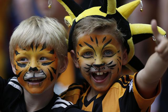 Hull City supporters cheer on their team before the start of their English FA Cup final soccer match against Arsenal at Wembley Stadium in London, Saturday, May 17, 2014. (AP Photo/Sang Tan)