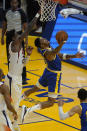 Golden State Warriors forward Kent Bazemore, right, shoots against Phoenix Suns center Deandre Ayton during the first half of an NBA basketball game in San Francisco, Tuesday, May 11, 2021. (AP Photo/Jeff Chiu)