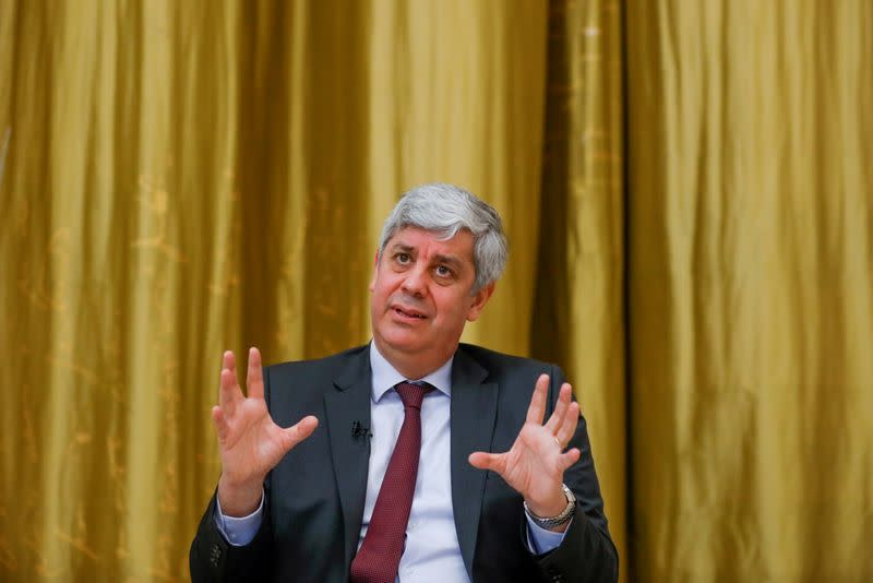 FILE PHOTO: ECB governing council member Mario Centeno speaks during an interview with Reuters, in Lisbon