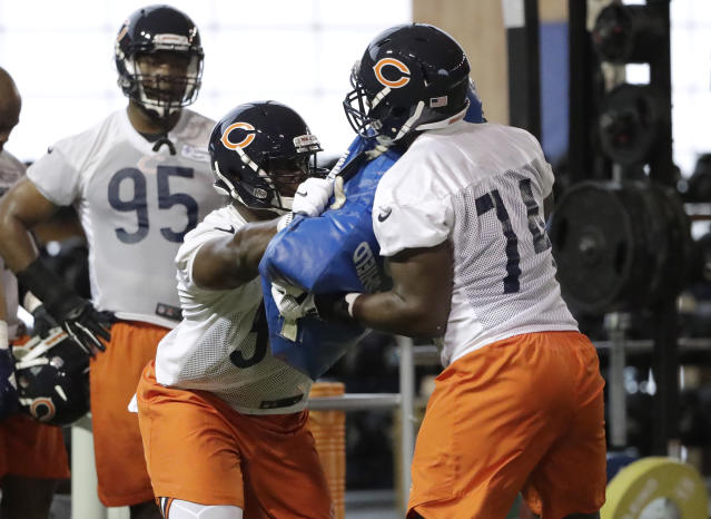 Chicago Bears defensive line Bilal Nichols (98) works with defensive line Bunmi Rotimi (74) during the NFL football team's rookie minicamp Friday, May 11, 2018, in Lake Forest, Ill. (AP Photo/Nam Y. Huh)