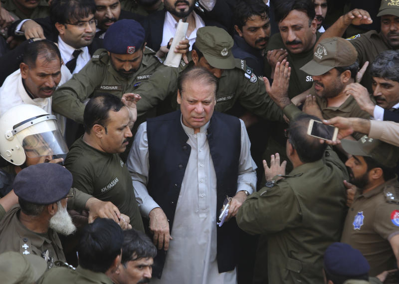 FILE - In this Friday, Oct. 11, 2019, file photo, Pakistani former Prime Minister Nawaz Sharif arrives at a court in Lahore, Pakistan. Sharif, who was convicted on corruption charges, has been rushed to hospital from the prison after recent blood tests raised doctors' concerns. (AP Photo/K.M. Chaudary,File)
