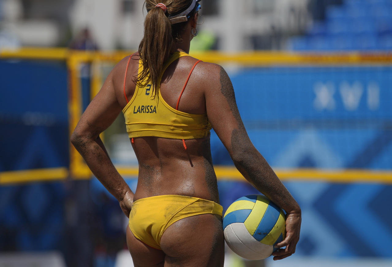 Brazil's Larissa Franca holds the ball before serving it during a women's beach volleyball match against Cuba at the Pan American Games in Puerto Vallarta, Mexico, Tuesday, Oct. 18, 2011. (AP Photo/Ariana Cubillos)