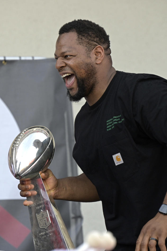 Tampa Bay Buccaneers defensive lineman Ndamukong Suh celebrates with the Vince Lombardi trophy during a celebration of their Super Bowl 55 victory over the Kansas City Chiefs after taking part in a boat parade, Wednesday, Feb. 10, 2021, in Tampa, Fla. (AP Photo/Phelan M. Ebenhack)
