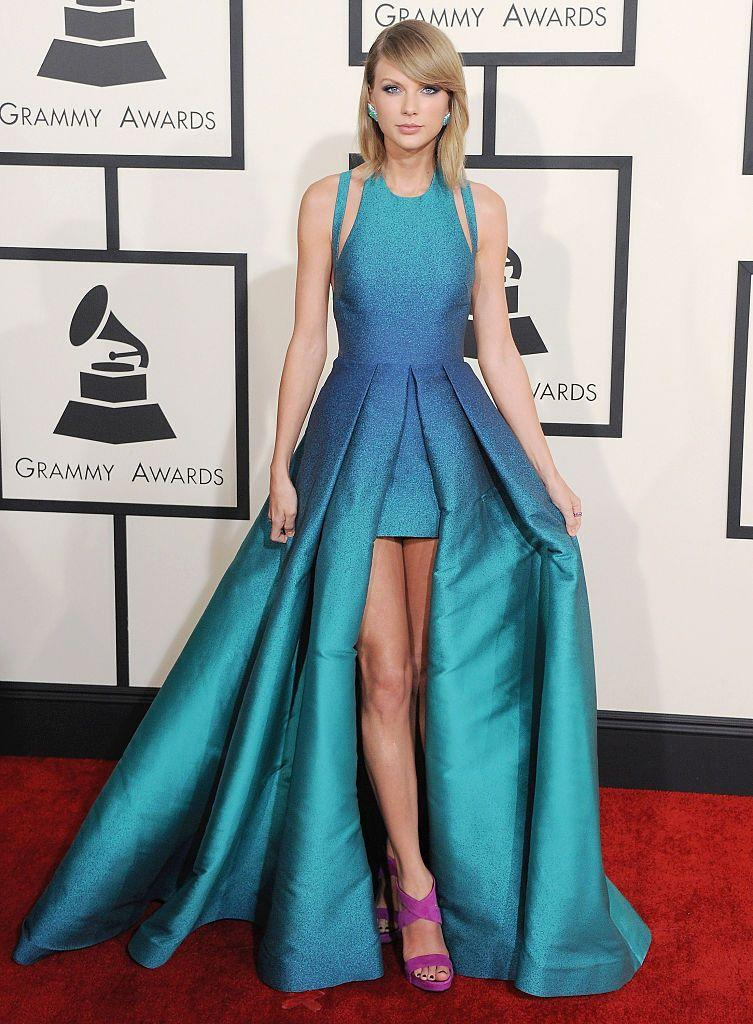 "<p>The 2015 Grammys signalled a goodbye to the ponytail/fringe/curly old Taylor we'd known to come and love and a heyyy to the 'cropped hair don't care' Taylor instead (which we also loved). </p><p>Wearing this gorgeous Elie Saab creation, Taylor used the night to <a href=""https://www.cosmopolitan.com/uk/entertainment/news/a41965/taylor-swift-kanye-west-feud-timeline/"" rel=""nofollow noopener"" target=""_blank"" data-ylk=""slk:publicly reunite and be pals with Kanye West"" class=""link rapid-noclick-resp"">publicly reunite and be pals with Kanye West</a> (which lasted long, eh) and <a href=""https://www.cosmopolitan.com/uk/entertainment/news/a33307/taylor-swift-obviously-did-some-really-great-dancing-at-the-grammys/"" rel=""nofollow noopener"" target=""_blank"" data-ylk=""slk:throw some wild shapes in the front row."" class=""link rapid-noclick-resp"">throw some wild shapes in the front row.</a></p>"
